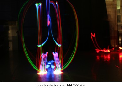 Rainbow Light trails on a black background
