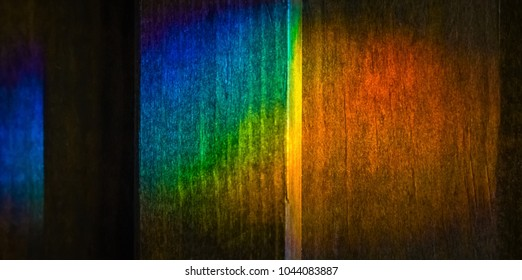 Rainbow lights refraction on wood-Abstract photography.