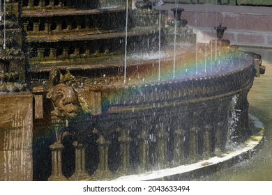 A rainbow is located on the fountain cascade. Close-up.