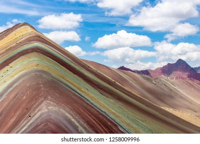 Rainbow Mountain -  is a mountain in Peru with an altitude of 5,200 meters above sea level. It's located in the Andes of Peru, in the Cusco Region.