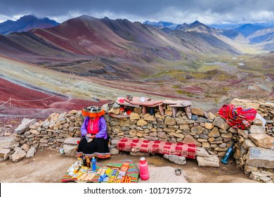 RAINBOW MOUNTAINES PERU - APRIL 25, 2017: Native peruvian woman wearing traditional clothes and selling souvenirs for tourists.
