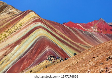Rainbow mountains or Vinicunca Montana de Siete Colores isolated on blue sky background, Cuzco region in Peru, Peruvian Andes, panoramic view