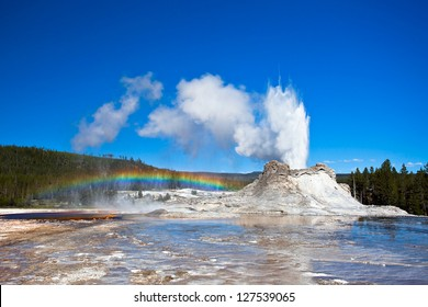 Rainbow near Castle geyser, Yellowstone National Park, Wyoming, USA