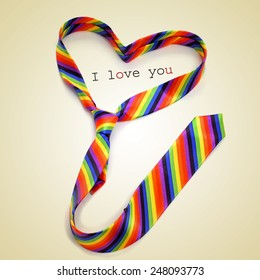 a rainbow necktie forming a heart and the text I love you written on a beige background, with a retro effect