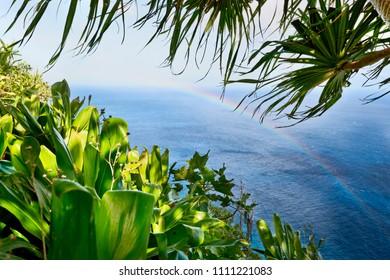 Rainbow off the Na Pali Coast, hiking along the Kalalau Trail, Kauai, Hawaii