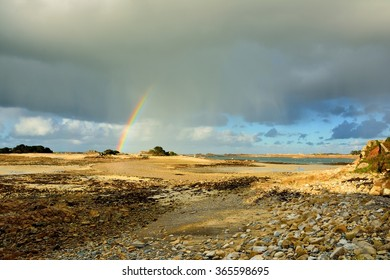 Rainbow on Penvenan Bay in Brittany at low tide