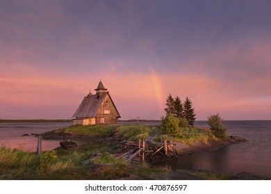 "Rainbow on pink sky after severe storm in the place where they filmed the famous movie ""The Island"" by the famous Russian film director Pavel Lungin.Village Rabocheostrovsk, Republic of Karelia,Russia"