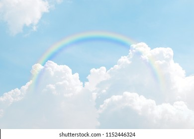 rainbow on sky blue and cloud background, rainbows rings circle on sky, colorful rainbow in the sky