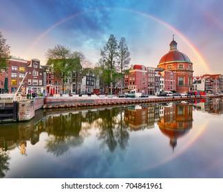 Rainbow over Amsterdam church Koepelkerk, Netherlands