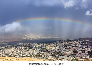 rainbow over the arab village Cana of Galilee ( Kafr Kanna ) in Israel , place where Christ showed first miracle