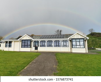 Rainbow over building in Dunoon, Scotland