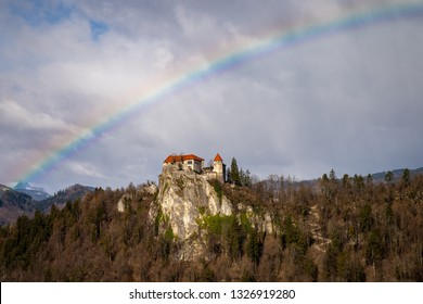 A rainbow over the castle on the top of the rocks Bled Slovenia