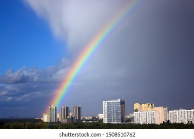 Rainbow over the city, against the background of high-rise buildings, in the city of Kiev