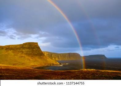 Rainbow over a dramatic coastline of Scottish highlands, Isle of Skye, United Kingdom, Europe
