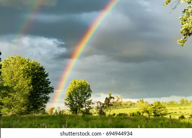 Rainbow over a farm field
