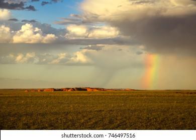 Rainbow over the Flaming Cliffs (Bajandsag) in the Gobi Desert, Mongolia.