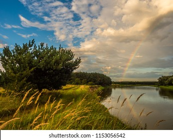 Rainbow over he Bug river. Podlasie. Podlachia. Poland, Europe. The region is called Podlasko or Podlasze. Panoramic view.