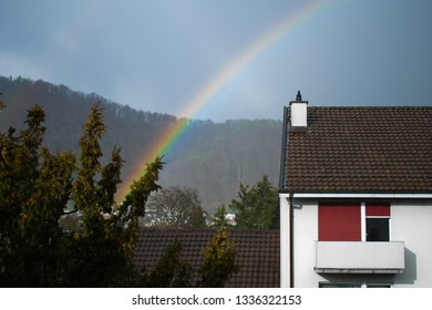 Rainbow over a house, Lausen, Switzerland, 8 March 2019