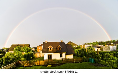 Rainbow over houses in small village