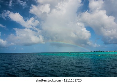 A rainbow over an island in Maldives.