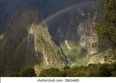 A rainbow over Machu Picchu Valley in Peru, South America