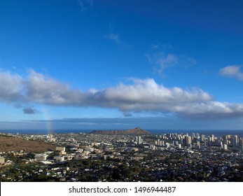 Rainbow over Manoa, the city of Honolulu, and Diamond Head on the island of Oahu in the state of Hawaii on a beautiful day.