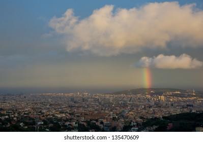 "Rainbow over ""Montjuic' hill on Barcelona city."