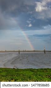 Rainbow over Norderney beach, travel  Germany