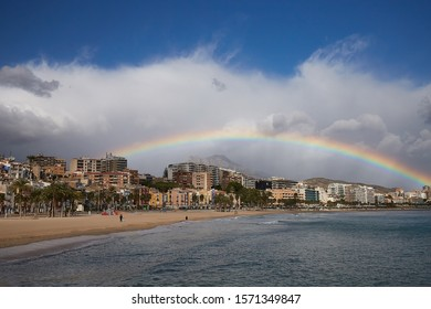 Rainbow over the old town of Villajoyosa with colorful houses, mountains and the sea, Spain.