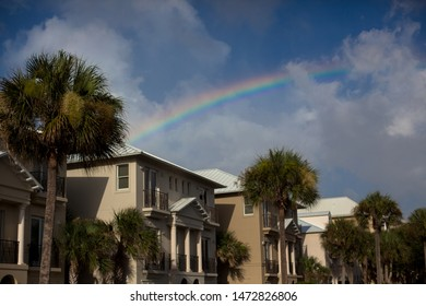 Rainbow over palm trees and beach houses