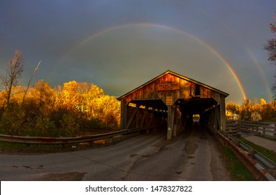 Rainbow over the Pulp Mill Bridge, a covered bridge that spans over Otter Creek in Middlebury, Vermont.