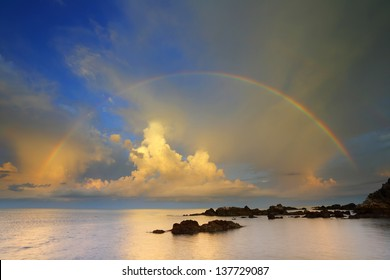 Rainbow over the sea and rock
