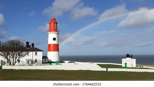 Rainbow over Souter lighthouse located at Whiburn in the northeast of England. - Shutterstock ID 1764662513