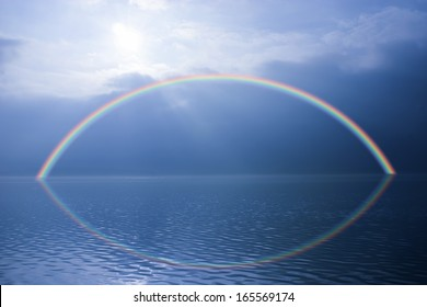 Rainbow over surreal water scape