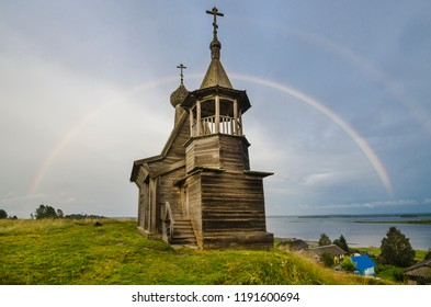 Rainbow over the temple. Church on a hill. Russia, Arkhangelsk region, Plesets district, Vershinino village