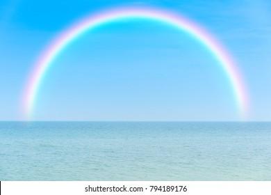 Rainbow over tropical sea and sky
