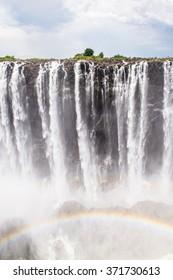 Rainbow over the Victoria Falls, boarder of Zambia and Zimbabwe. UNESCO World Heritage