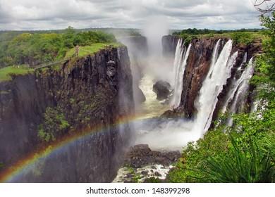 Rainbow over Victoria Falls on Zambezi River, border of Zambia and Zimbabwe