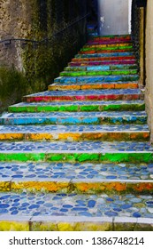 A rainbow painted flight of stone stairs outdoors in Pau, the South of France