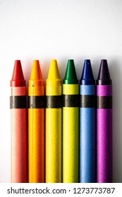 Rainbow pattern crayon colors on a white background