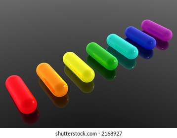 rainbow pills on black background