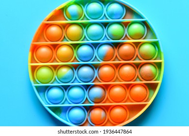 Rainbow Pop it fidget toy on a empty copy space background
