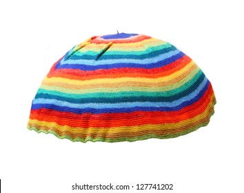 9cd049764d6 Rainbow rasta cap isolated on a white background. Homemade knitted product.