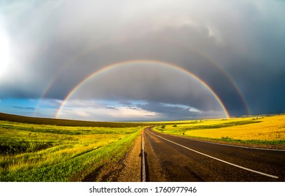 Rainbow road after rain in spring travel