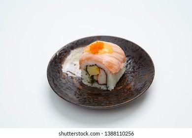 Rainbow Roll or rainbow maki on white background. Japanese sushi food.
