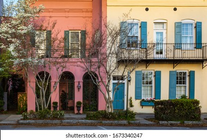 Rainbow row of colorful home exteriors along the street of downtown Charleston, South Carolina in spring.