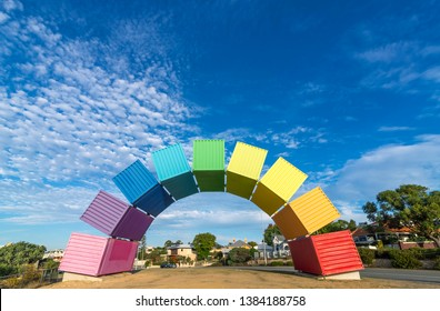 A rainbow of sea containers against a beautiful blue sky in Fremantle, Western Australia