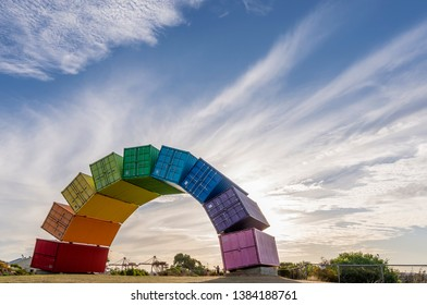 A rainbow of sea containers against a beautiful sunset in Fremantle, Western Australia