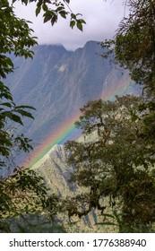 Rainbow seen through vegetation down above Urubamba river valley, on Inca Trail to Machu Picchu, Peru