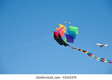 """Rainbow Ship"" kite on sky and clouds background"